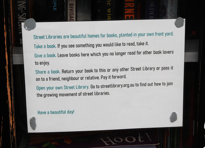 Street library sign.