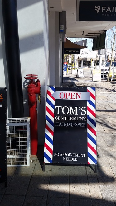 Tom's Traditional Barber shop is at the Bay View Terrace end of Old Theatre Lane