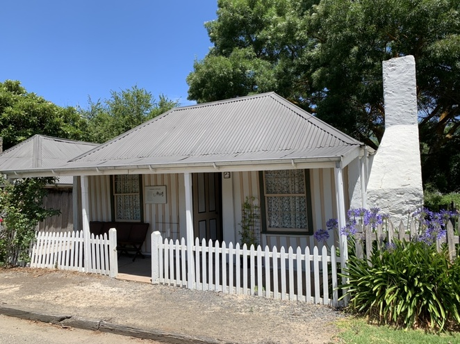four-room cottage of sawn slabs