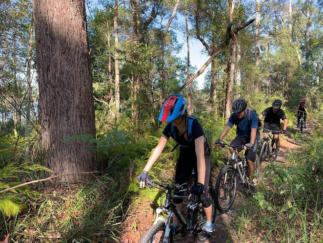 Learn to Mountain Bike, Healthy Sunshine Coast, Adventure Sunshine Coast, CORCA, Caloundra Off Road Cycling Association Inc, wind in your hair, biking in the bush, popular sport, qualified instructors, build confidence, lessen risk of injuries, outdoors, healthy, family-friendly activity, teenagers, adults, key points of Mountain Biking, practice learned skills, supervised ride Sugarbag Road Trails, beginners or accomplished, Sunday mornings, Maddock Park on Ewen Maddock Dam, Tunnel Track, Dularcha National Park