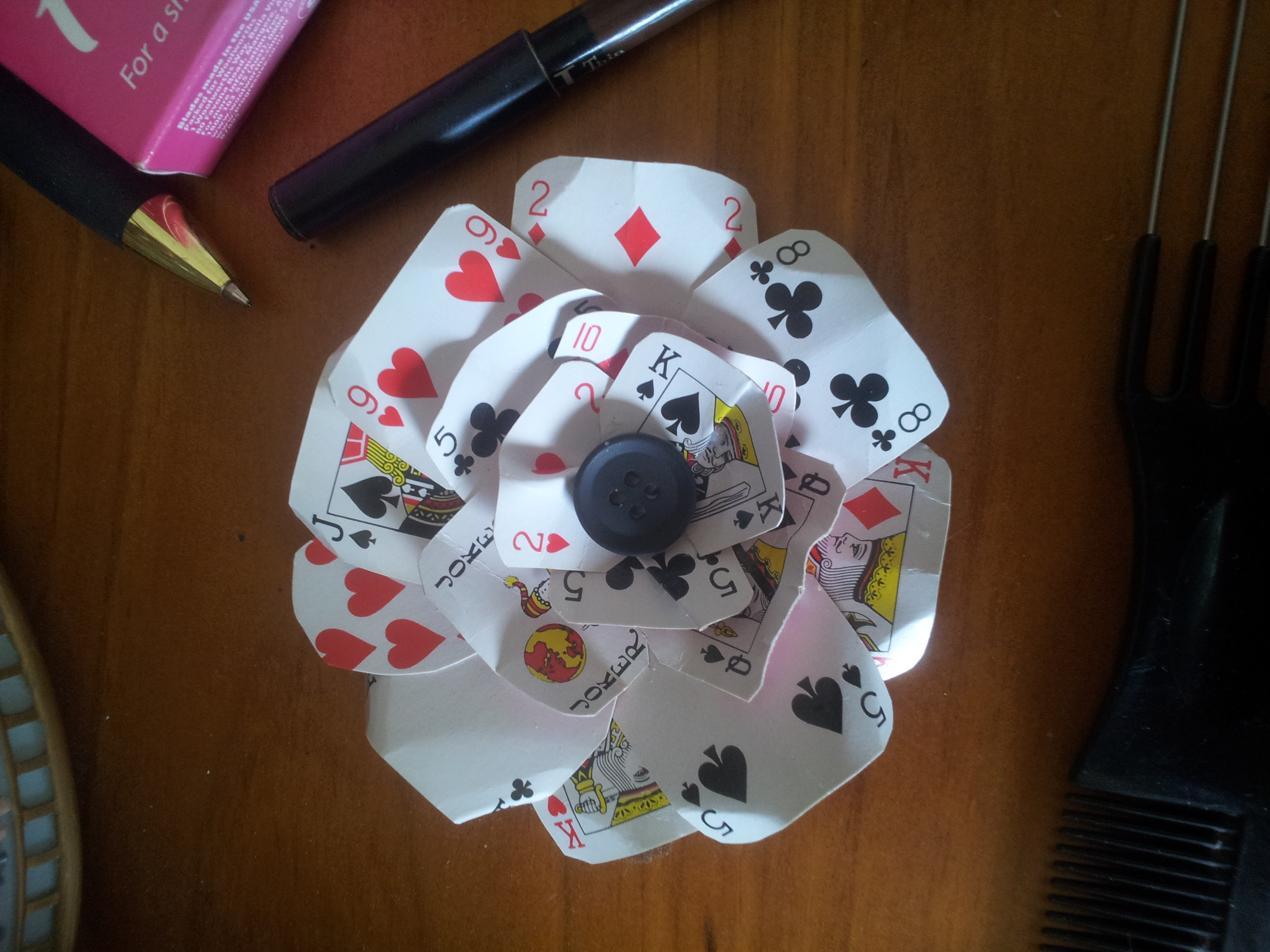 Playing Card Flower Decoration. Cowgirl Decorations. World Home Decor. Online Home Decor Sites. Halloween Cemetery Decorations