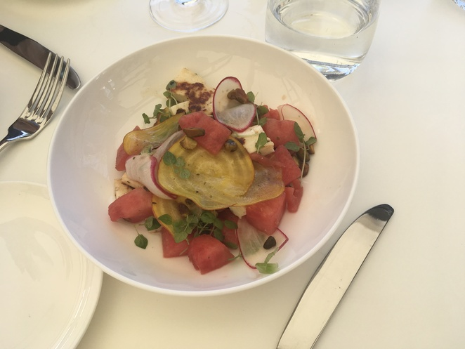 A entree of H20 Melon and Haloumi{GF} with lemon Balm ,Mint, Roasted Pistacho and Chardonnay Vinegar