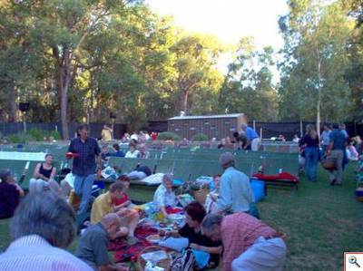 Patrons enjoying a picnic at the Kookaburra Outdoor Cinema before the movies begin. Image is from the Kookaburra Outdoor Cinema website.