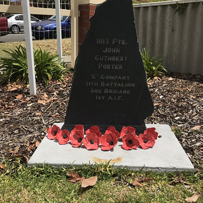 ANZAC Cottage Remembrance Day Commemoration.The memorial stone erected in the front yard of ANZAC Cottage dedicated to Private John Porter, the original recipient of ANZAC Cottage. Ceramic poppies by Dawn