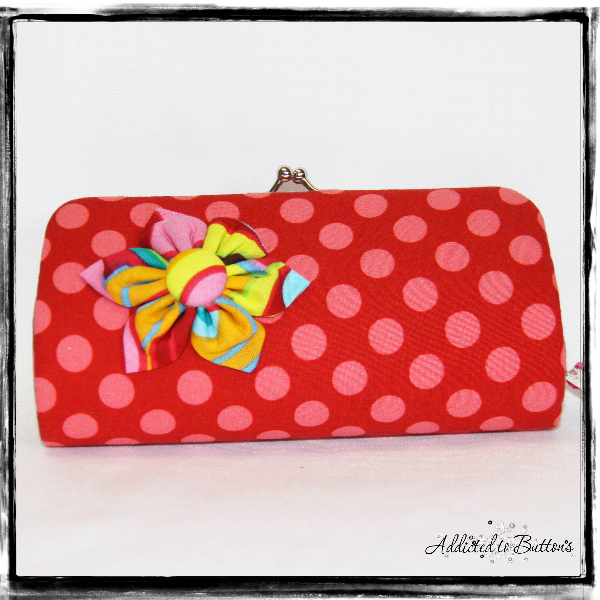 Clutch bag with button