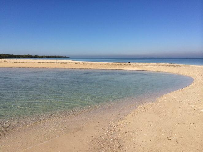 This sandy bay appears on Green Island as the tide goes out