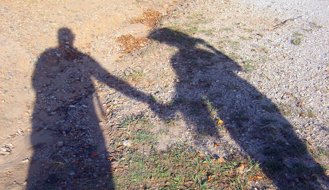 Shadows holding hands