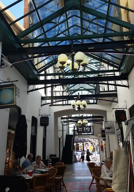 Beautiful archways frame this historic Old Theatre Lane, part of a bygone era now a bustling chic market