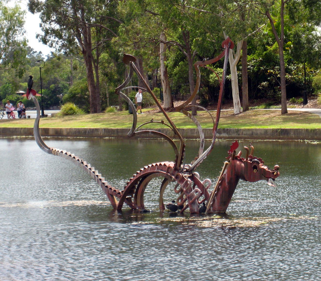 Forest lake has several artworks in the water