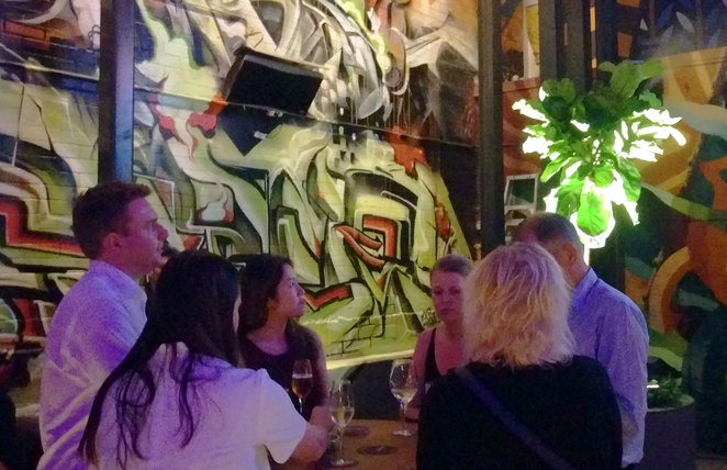 The small beer garden at the Osbourne Hotel is brought to life by walls covered by murals