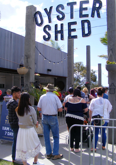 A queue at the Oyster Shed during one of the Sandstone Point Hotel's many festivals