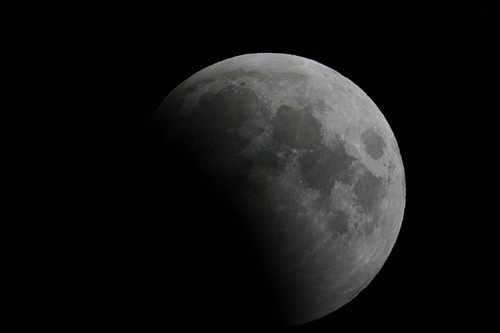 Photo of a partial lunar eclipse courtesy of Jörg Weingrill @ Flickr