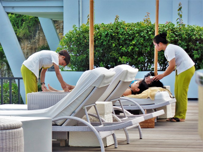 poolside massage at Samabe Bali Suites & Villas