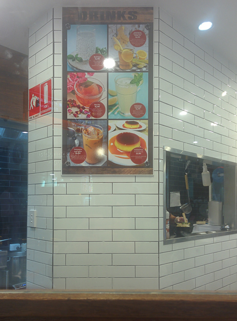 The drinks menu at Pho Dau with the kitchen window.