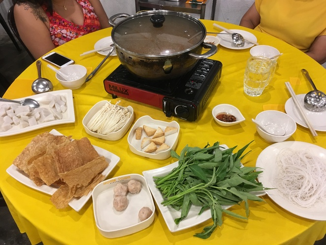 Steam Boat and ingredients; Top fish balls, mushroom, fish cake Bottom : tofu skin, prawn balls, spinach,vermicelli