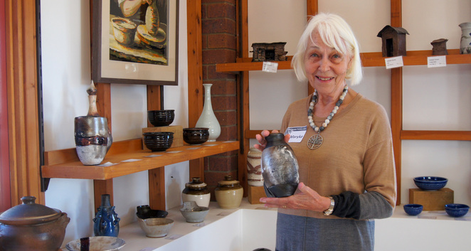 A potter talking about her works at the gallery