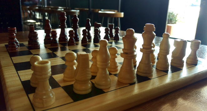Playing chess at Sasquatch Bar in Chermside
