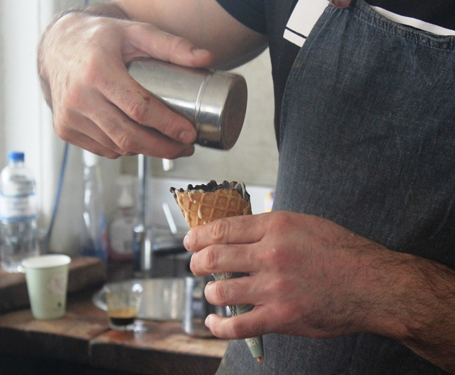Finishing touches to the coffee in a cone