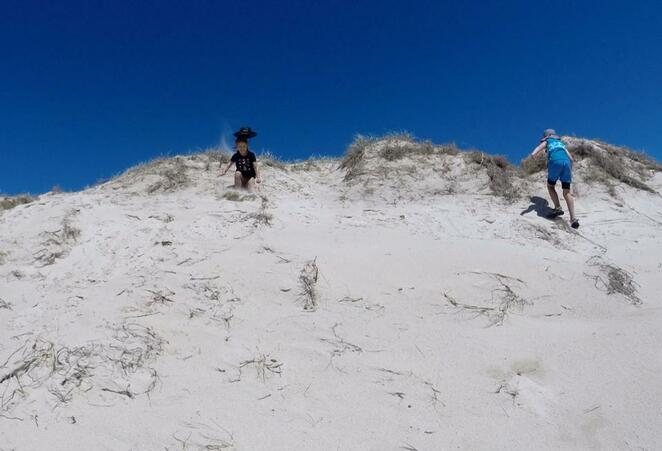 Playing on the sand dunes on the surf-beach side of South Stradbroke Island