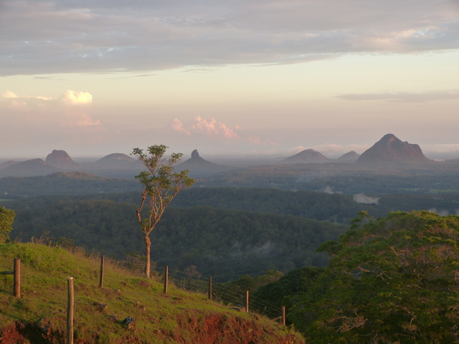 Glass mountains bathed with colours of setting sun One Tree Hill Maleny