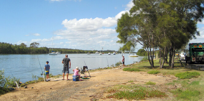 Family fishing at the estuary at Nudgee Beach