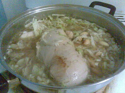 Chicken and stock on low heat