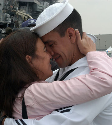 Hospital Corpsman 1st Class Mario Martin, embraces his fiancée after a successful marriage proposal. Petty Officer Martin is currently assigned to the destroyer USS Fletcher (DD 992). Fletcher arrived at Naval Station San Diego, two years and four crews after deploying as the first of two Sea Swap Platforms. The former Pearl Harbor, Hawaii based ship will be decommissioned in October.