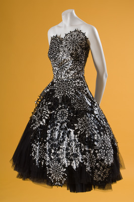 Alexander McQueen, evening dress, black leather, white silk, black tulle, fall 2008, France, museum purchase. Photograph ©The Museum at FIT.