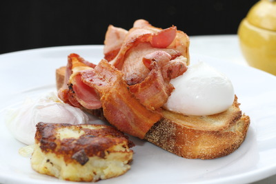 Poached eggs on toast with a side of bacon & potato rosti