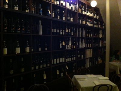 one of the impressive walls of wine at 1889 Enoteca