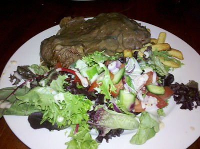 steak with chips and salad