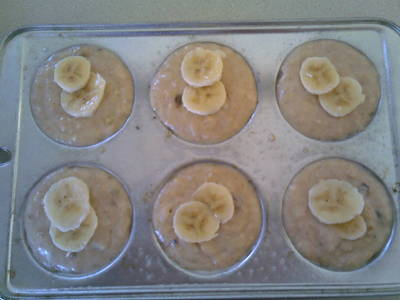 Muffin mix with sliced banana on top.