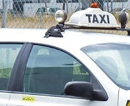 Taxi sign on cab
