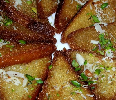 Sweet Toast garnished with saffron, cardamom, almonds and pistachios